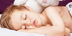Why does a child grit his teeth in his sleep